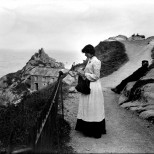 Jane Joliff (nee Mark 1879 -1955) using a knitting stick on the cliff path overlooking Peak Rock, Polperro in 1904.